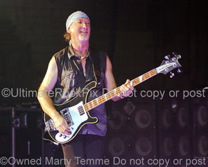Photo of Roger Glover of Deep Purple playing a Rickenbacker bass in concert in 2007 by Marty Temme