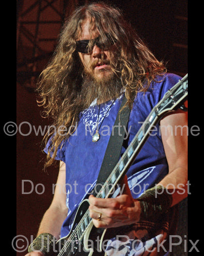 Photo of Robin Finck of Guns N' Roses playing a Gibson Les Paul in concert by Marty Temme