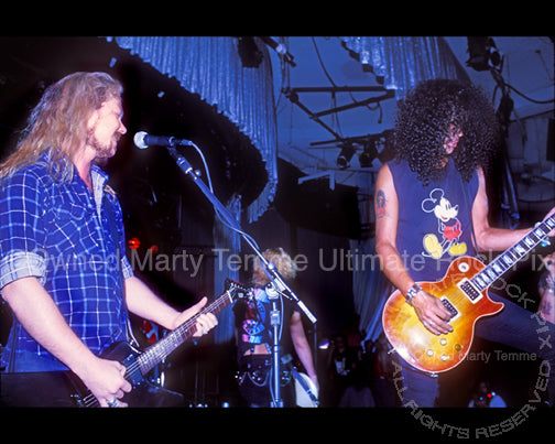 Photo of James Hetfield and Slash playing together onstage in 1990 by Marty Temme