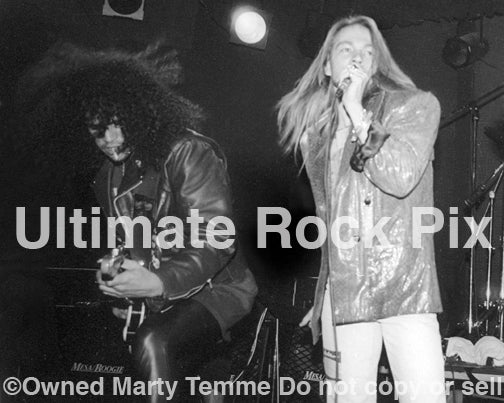Black and white photo of Axl Rose and Slash of Guns N' Roses in concert in 1989 by Marty Temme