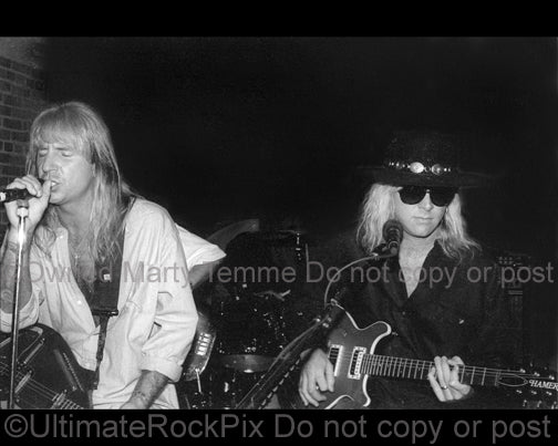Photo of Jack Russell and Mark Kendall of Great White in concert in 1994 by Marty Temme