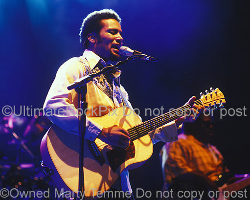 Photo of Ben Harper playing a Cole Clark acoustic guitar in concert in 2004 by Marty Temme