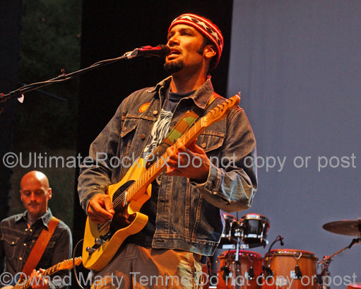 Photo of Ben Harper playing a Telecaster in concert in 2006 by Marty Temme