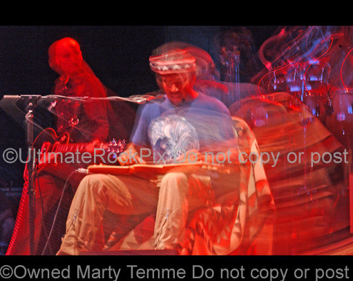 Art Print of Ben Harper playing a lap steel guitar in concert by Marty Temme