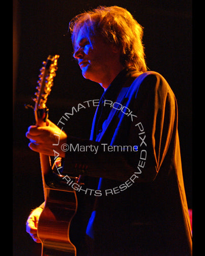 Photo of guitarist Craig Bartock of Heart in concert by Marty Temme