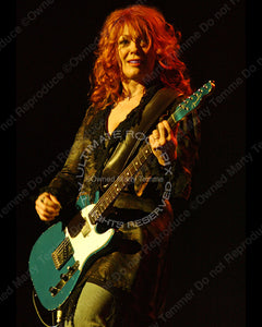 Photo of Nancy Wilson of Heart in concert in 2007 by Marty Temme