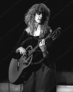 Photo of guitar player Nancy Wilson of Heart in concert in 1980 by Marty Temme