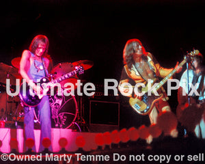 Photo of Steve Marriott and Greg Ridley of Humble Pie in concert in 1973 by Marty Temme