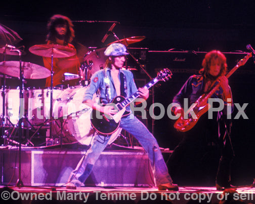 Photo of Steve Marriott and Greg Ridley of Humble Pie in concert in 1975 by Marty TemmePhoto of Steve Marriott and Greg Ridley of Humble Pie in concert in 1975 by Marty Temme