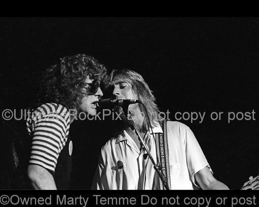 Photo of Ian Hunter and Mick Ronson in concert in 1979 by Marty Temme