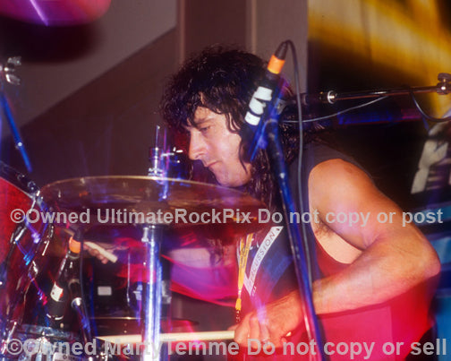 Photo of drummer Jay Schellen in concert in 1994 by Marty Temme