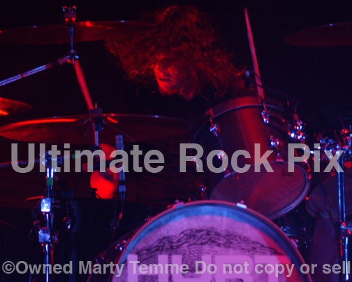 Photo of drummer Evan Johns performing with the band Hurt in concert in 2006 by Marty Temme