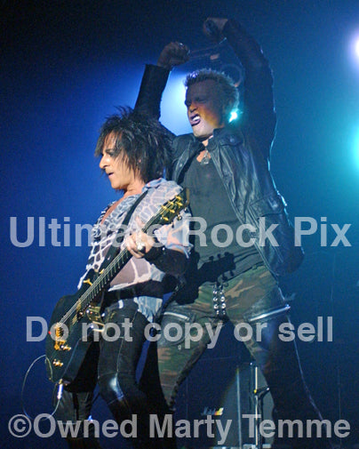 Photo of singer Billy Idol and Steve Stevens onstage in 2005 by Marty Temme