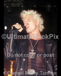 Photo of vocalist Billy Idol in concert in 1990 by Marty Temme
