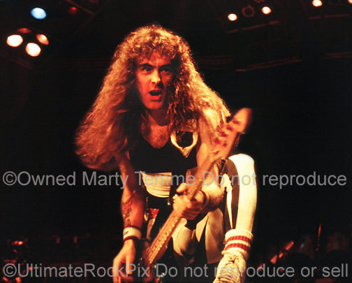 Photo of bass player Steve Harris of Iron Maiden onstage in 1985 by Marty Temme