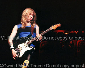 Photo of guitar player Dave Murray of Iron Maiden in concert 1985 by Marty Temme