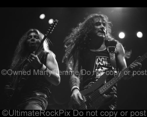 Photo of Dave Murray and Steve Harris of Iron Maiden in concert in 1991 by Marty Temme