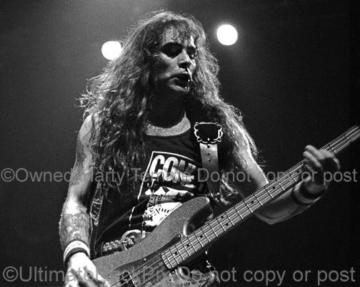 Black and white photo of bassist Steve Harris of Iron Maiden in concert in 1991 by Marty Temme