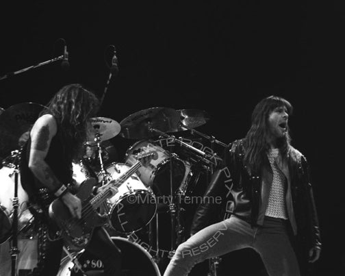 Black and white photo of Bruce Dickinson and Steve Harris in concert in 1991 by Marty Temme
