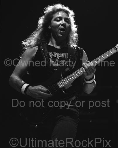 Black and white photo of guitarist Dave Murray of Iron Maiden in concert in 1991 by Marty Temme