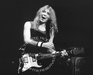 Black and white photo of Dave Murray of Iron Maiden in concert in 1985 by Marty Temme