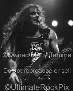 Black and white photo of Steve Harris of Iron Maiden onstage in 1991 by Marty Temme