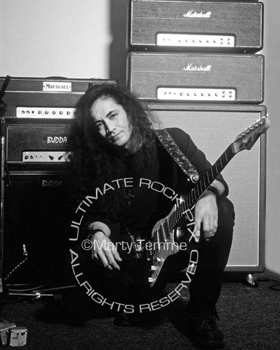 Black and white photo of Jake E. Lee with his guitar and amps in 1995 by Marty Temme