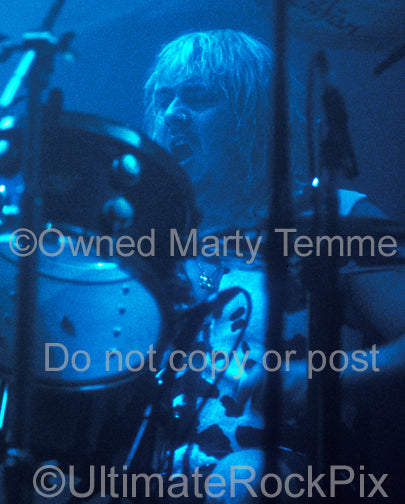 Photo of drummer Jason Bonham in concert in 1992 by Marty Temme