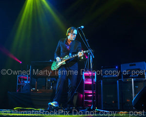 Photo of Joe Bonamassa playing a green Les Paul in concert by Marty Temme