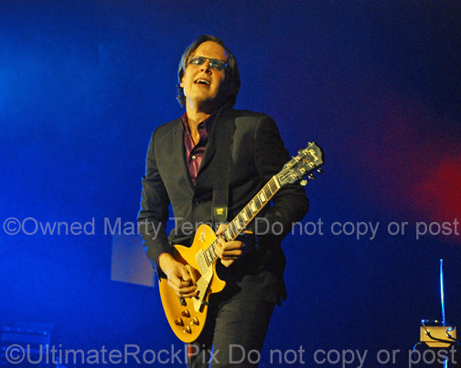 Photo of Joe Bonamassa playing a Les Paul Goldtop in concert by Marty Temme