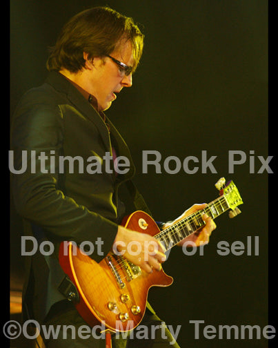 Photo of Joe Bonamassa playing a Les Paul Standard in concert by Marty Temme