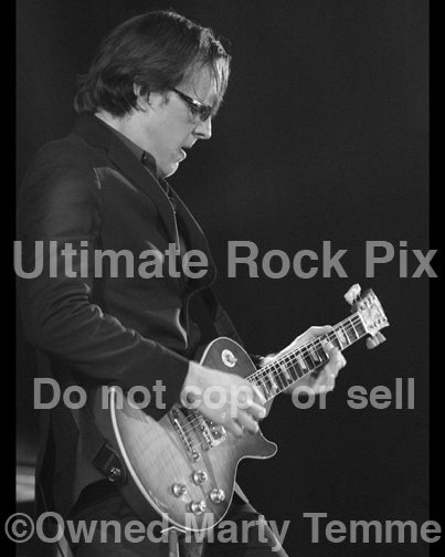 Black and white photo of Joe Bonamassa playing a Les Paul in concert by Marty Temme