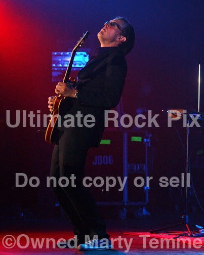 Photo of Joe Bonamassa playing a Les Paul in concert by Marty Temme