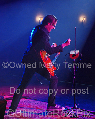 Photo of Joe Bonamassa playing a doubleneck guitar and a theremin in concert by Marty Temme