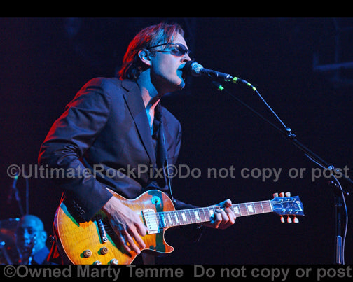 Photo of Joe Bonamassa playing a sunburst Les Paul in concert by Marty Temme