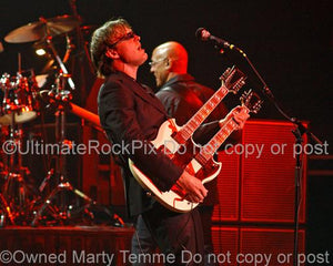 Photos of Joe Bonamassa playing a White Gibson Doubleneck SG in Concert by Marty Temme