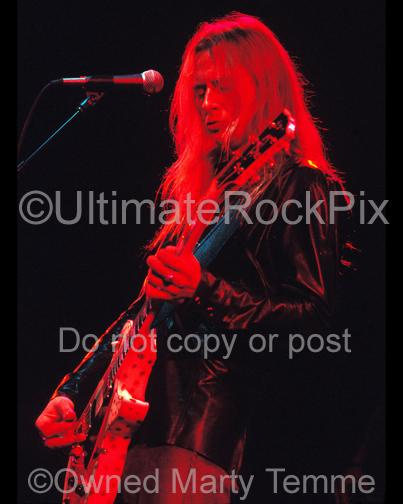 Photo of Jerry Cantrell playing a white Les Paul in concert in 2002 by Marty Temme