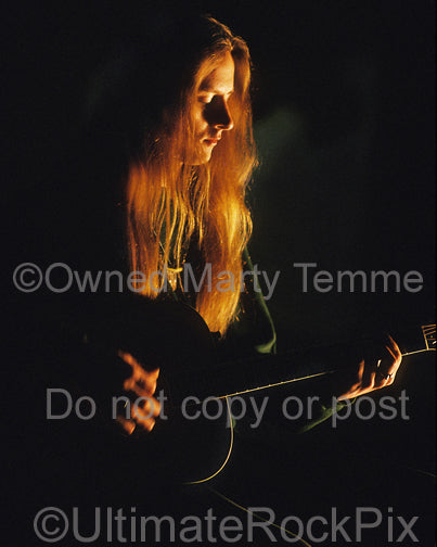 Photo of Jerry Cantrell of Alice In Chains playing an acoustic guitar by Marty Temme