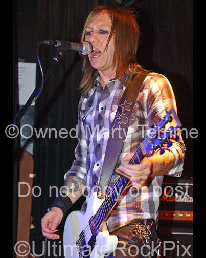Photo of guitarist Billy Rowe of Jetboy in concert in 2008 by Marty Temme