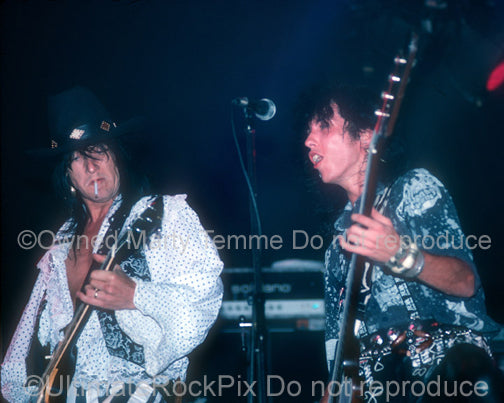 Photo of Nasty Suicide of Hanoi Rocks and Sami Yaffa of Jetboy in concert in 1988 by Marty Temme