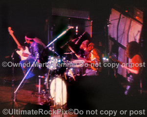 Photo of Jimi Hendrix, Mitch Mitchell and Noel Redding performing in concert in 1969 by Marty Temme