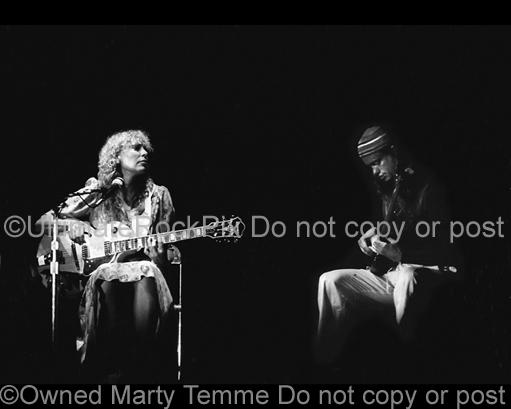 Black and White Photos of Joni Mitchell Playing an Ibanez Guitar with Bassist Jaco Pastorious in Concert in 1979 by Marty Temme