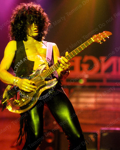 Photo of guitar player Joe Perry in concert in 1990 by Marty Temme