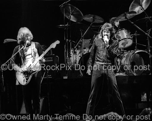 Photo of Paul Kantner, Mickey Thomas and Aynsley Dunbar of Jefferson Starship in concert in 1980 by Marty Temme