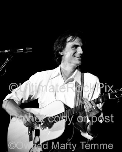 Photo of singer-songwriter James Taylor in concert in the 1970's by Marty Temme