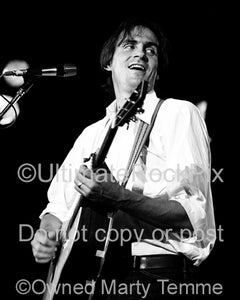 Black and white photo of singer-songwriter James Taylor in concert in the 1970's by Marty Temme