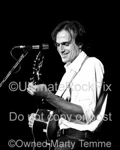 Black and white photo of musician James Taylor in concert in the 1970's by Marty Temme