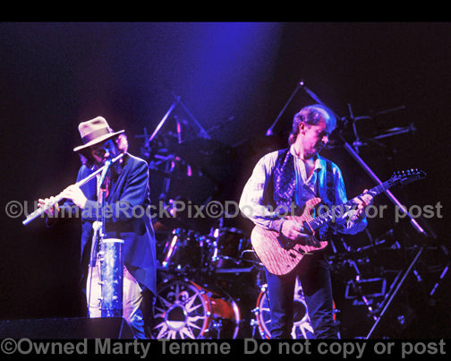 Photo of Ian Anderson and Martin Barre of Jethro Tull in concert in 1989 by Marty Temme