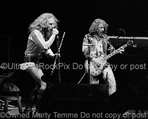 Photo of Ian Anderson and Martin Barre of Jethro Tull in concert in 1973 by Marty Temme