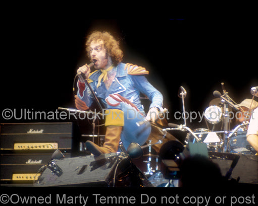 Photo of Ian Anderson of Jethro Tull performing onstage in 1976 by Marty Temme